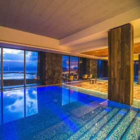 Swimming pool area at night, Hotel Arakur Ushuaia Resort and Spa, Ushuaia, Tierra del Fuego, Patagonia, Argentina